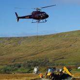 Donated stone air lifted by helicopter used to repair two stretches of the Three Peaks pathway in the Yorkshire Dales National Park.